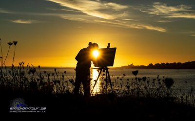 Maler im Sonnenuntergang